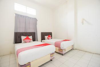 OYO 1111 Passer Baroe Inn Near RS Siloam Pasar Baru Jakarta - Standard Twin Room Regular Plan