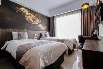 Hotel Unisi Yogyakarta Syariah Yogyakarta - Deluxe Twin Room Only Regular Plan