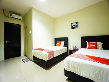 OYO 1769 Rid's Hotel Manado - Standard Twin Room Regular Plan
