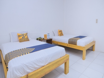 SPOT ON 2134 Seunia Hotel Banda Aceh - Deluxe Twin Room Regular Plan
