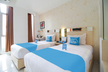 Airy Lowokwaru Sutoyo 22 Malang - Deluxe Twin Room with Breakfast Regular Plan