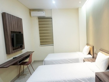 Djuragan Kamar Priority Inn Solo - Deluxe Twin Regular Plan