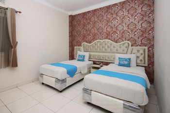 Airy Syariah Pelajar Pejuang 45 Bandung - Deluxe Twin Room with Breakfast Regular Plan