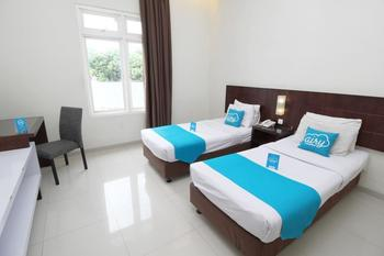 Airy Candisari Sisingamangaraja 4 Semarang - Deluxe Twin Room with Breakfast Regular Plan