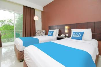 Airy Candisari Sisingamangaraja 4 Semarang - Grand Deluxe Twin Room with Breakfast Special Promo Oct 50