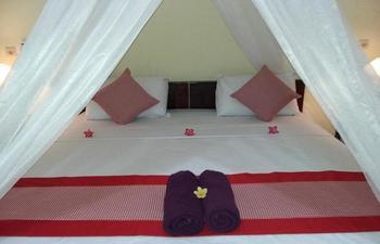 Komang Homestay Bali - Standard Garden View with AC Regular Plan