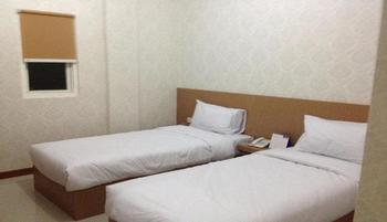 Value Room Mall Panakkukang at 3G Home Stay Makassar - Twin Room Regular Plan