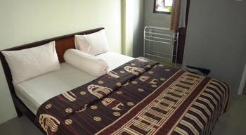 Bunga Matahari Guest House Malang - Junior Room Plus Regular Plan