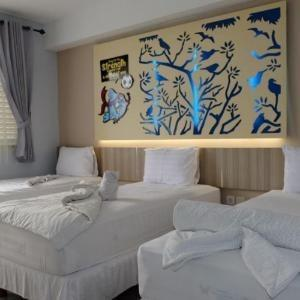 Transformer Center Hotel Malang - DELUXE TRIPLE ROOM Regular Plan