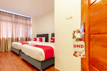 OYO 1457 Tmj Guest House Medan - Suite Family Regular Plan