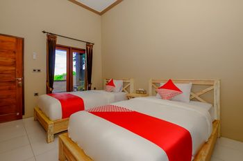 OYO 2823 Artati Bungalows And Restaurant Lombok - Deluxe Twin Room Regular Plan