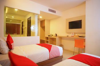 Capital O 166 Hotel Princess Palembang - Deluxe Twin Room Regular Plan