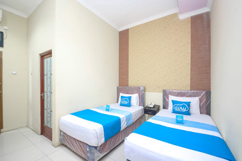 Airy Sadang Veteran 1 Purwakarta - Deluxe Twin Room Only Regular Plan