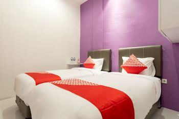 OYO 839 Royal Guest House Medan - Standard Twin Room Regular Plan
