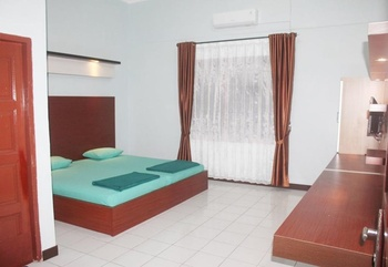 Mexicana Hotel Jambi - Deluxe Room Only with AC Regular Plan