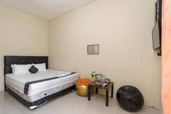 Madinah House Syariah Depok - Standard Room KETUPAT