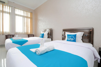 Airy Medan Baru Mataram 21 - Standard Twin Room Only Regular Plan