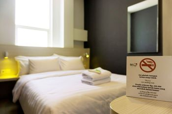 Red Orchid Simpang Lima Semarang - Deluxe Double Room Only Regular Plan