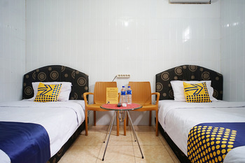 SPOT ON 1854 Sepinggan Asri Syariah Guesthouse Balikpapan - Standard Twin Room Regular Plan