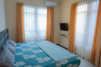 Green Surabaya Homey (Syariah) Surabaya - Triple Room (AC + TV) Regular Plan