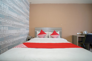 OYO 736 Hotel Best Skip Palembang - Deluxe Double Room Regular Plan
