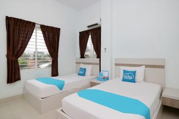 Airy Eco Syariah Medan Petisah Ayahanda Ceret 11C - Deluxe Twin Room Only Special Promo Apr 24