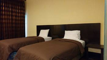 Quint Hotel Manado - Deluxe Room Regular Plan