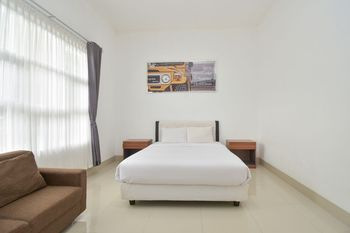 Wisma Jip by Stayku Yogyakarta - Deluxe Double Room Regular Plan