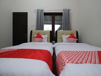 OYO 2231 D'kost Pangkalpinang - Deluxe Twin Room Regular Plan