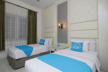 Airy Cicendo Otten 6 Bandung - SuperiorTwin Room with Breakfast Special Promo Sep 60