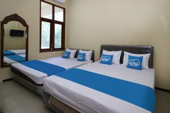 Airy Syariah Manunggal Kebonsari 9A Surabaya Surabaya - Standard Family Room With Breakfast Regular Plan