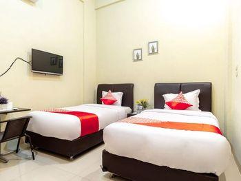 Oyo 1349 Green Elite Syariah Medan - Standard Twin Room Regular Plan