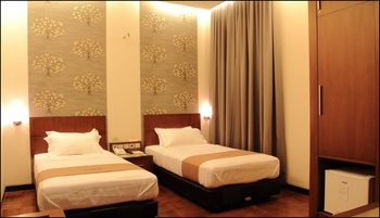Omah Qu Guesthouse by Symphony Yogyakarta - Deluxe Twin Room Only Regular Plan