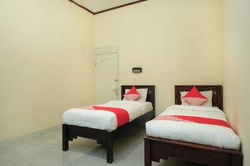 OYO 561 Hotel Citra Indah Near RS Ludira Husada Tama Yogyakarta -  Standard Twin Room Regular Plan
