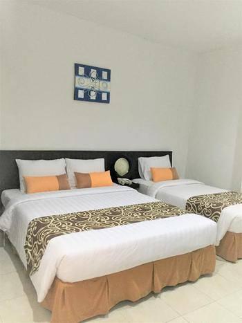 Grand Pudjawan Hotel Bali - Deluxe Triple Room RO Midnight Sale Promo
