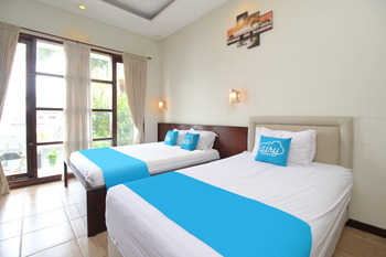 Airy Syariah Lowokwaru Sigura Gura Empat 1 Malang Malang - Family Room with Breakfast Regular Plan