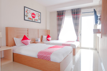 OYO 696 Hasanah Guest House Syariah De Saphire Malang - Deluxe Twin Room Regular Plan