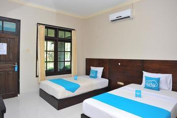 Airy Lombok Tengah Raya Pantai Kuta - Bungalow Twin Room with Breakfast Regular Plan