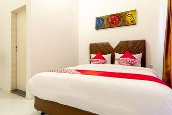 OYO Flagship 1794 Kamojo Gh Medan Medan - Standard Double Room Regular Plan