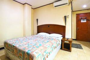 King Stone Hotel South Tangerang - Bedroom