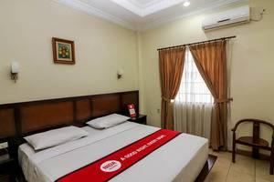 NIDA Rooms Sudirman 255 Pekanbaru Pekanbaru - Kamar tamu