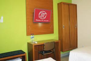 Maleosan - Inn Manado Manado - Kamar tamu