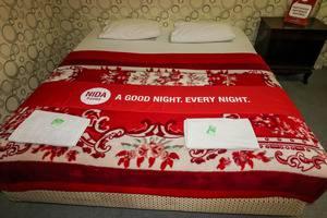 NIDA Rooms Bogor Cisarua Mawar Bogor - Kamar tamu