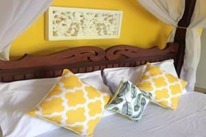 Kirana Homestay Bali - Kamar tidur
