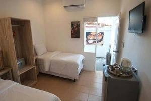 Scallywags Mango Motel Lombok - Kamar tamu