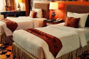 Grand Rocky Hotel Bukittinggi - twin bed in Interconnecting Deluxe Room