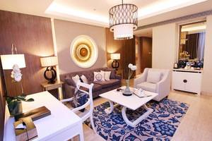 Grand Aston Yogyakarta - Living room Chinoseries Suite room