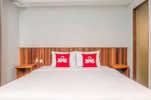 ZenRooms Raya Kuta Joger - Tampak tempat tidur double