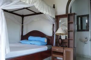 C'est Bon Homestay 1 Bali - Kamar tidur pemandangan laut