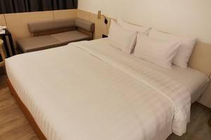 GAIA Cosmo Hotel Jogja - Ruang tamu dengan tempat tidur King